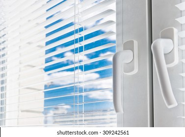 Window with white jalousie, close up