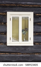 Window with white paint in the cabin.