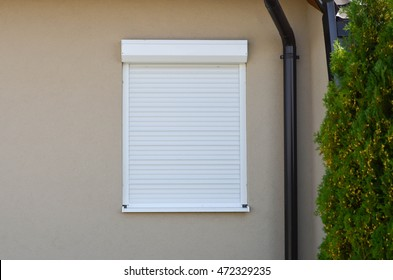 Window with white rolling shutter