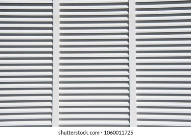 Window with white shutters in st.thomas, british virgin island. Blinds closed on sunny day outdoor. Frame, structure and design background.