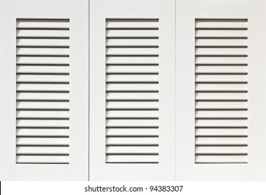 Window with white wooden shutters