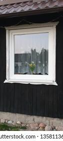 Window in wooden house