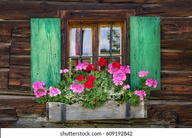 Window of a wooden mountain hut in the alps