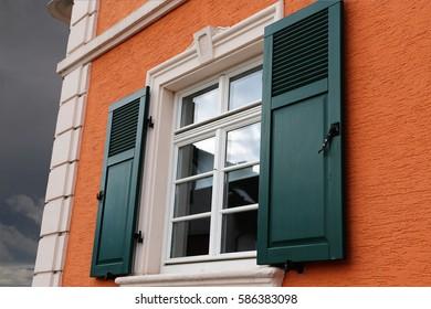Window with wooden shutter, exterior shot