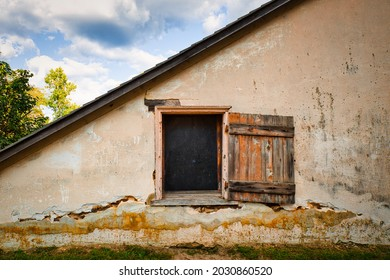 Window and wooden shutter at the side of an old building in Batsto village in the Pine Barrens of NewJersey, USA