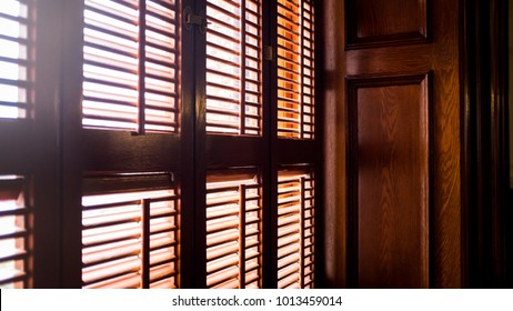 Window with wooden shutters and sunlight