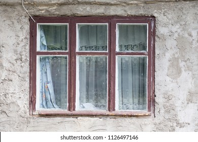 Window in the world. The old window is located on the front of an old house.