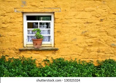 Window in yellow wall of an Irish cottage