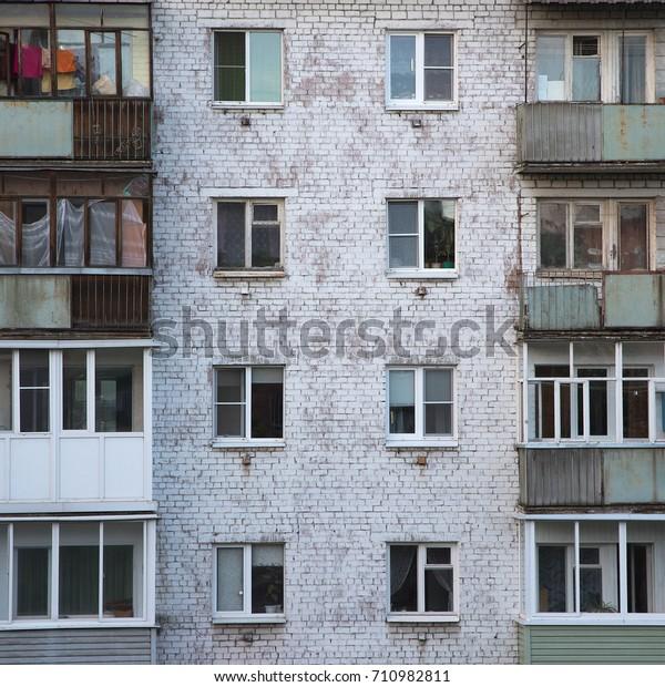 Old Brick Apartment Building: Windows Balconies Old Brick Apartment Building Stock Photo