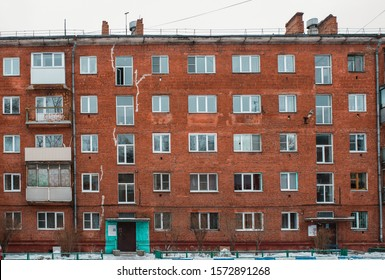 Windows and balconies of an old brick residential building in Russia. need repair for an apartment