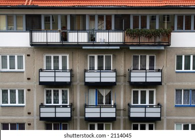 Windows and balcony in an apartment building.