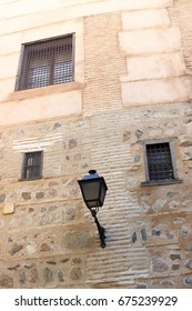 Windows with bars in medieval convent on a street in Toledo, Spain, world heritage city,