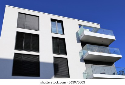 Windows with blinds on a apartment building