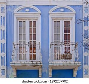 Windows in a blue facade in Oranjestad, Aruba