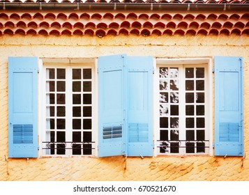 Windows with blue shutters, beautiful details of provencal typical small old town in Provence, France, retro toned
