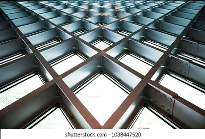 Windows and blue/gray steel beams forming a v-shaped/diamond-shaped pattern at the public library in Seattle, Washington (United States)