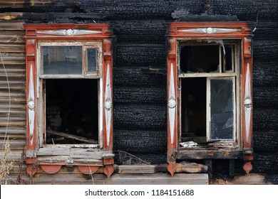 windows of burnt house ruin. half of the burnt house. half the house is intact