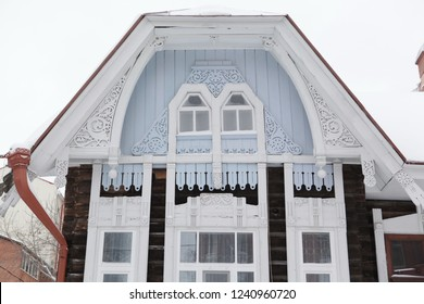 Windows with carved frames on wooden house in Tomsk city (Russia)
