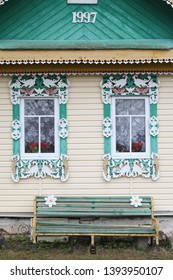 """Windows with carved frames on wooden rural house (""""dacha"""") in Sedelnitsy village (Ivanovo region, Russia). Russian style in architecture"""