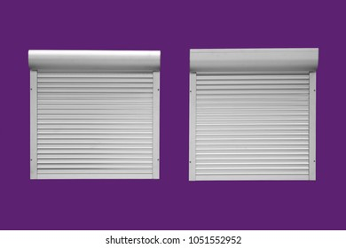 Windows with closed white metal blinds on purple wall