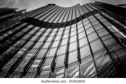 windows of commercial building in Hong Kong with B&W color