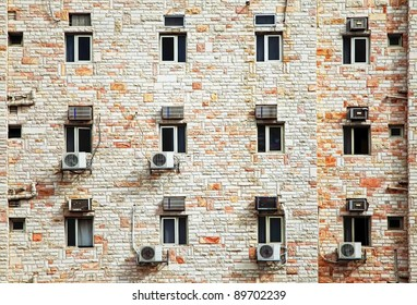 Windows and conditioners of the modern office building constructed of the Jerusalem stone