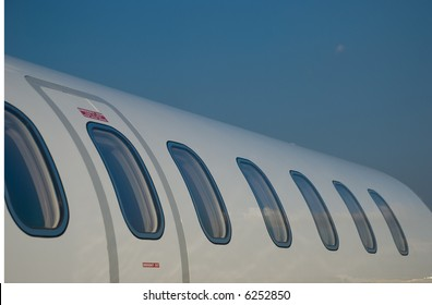 Windows and fuselage of a private jet