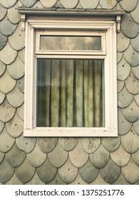 Windows at gray wall