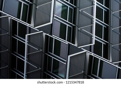 Windows and metal security grids. Collage photo of building exterior fragments with reflections and shadows. Abstract image on the subject of modern architecture, industry or technology.