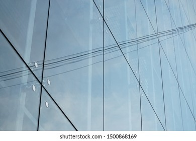 Windows of modern architecture in high-rise buildings. Glass facade building wall.