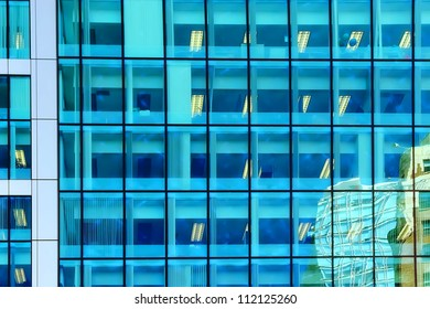 Windows of a modern office building with reflections
