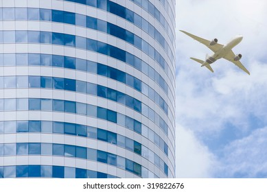 windows of office building and airplane,business financial district concept