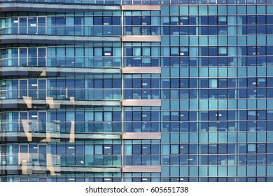Windows of offices in a building of Milan, Italy