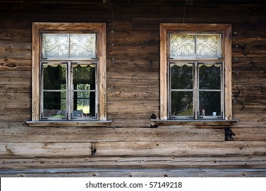 Windows of old, wooden cottage in the countryside