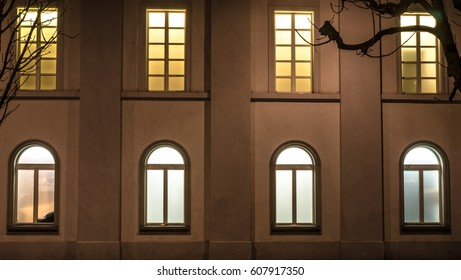 The windows on the apartment wall during the night