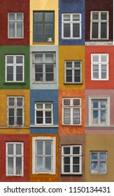 Windows on the colorful facades from Nyhavn harbour, Copenhagen, Denmark
