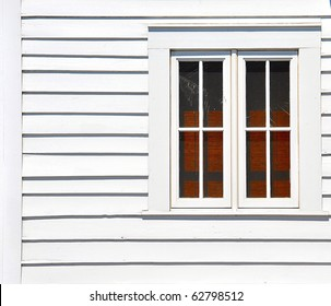 Windows On White Wall With Bamboo Curtains