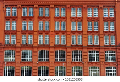 Windows of the red brick house in Moscow, Russia