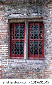 Windows with red wooden frame.