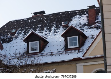 Windows and roof after snowfall.