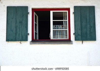 Windows with shutters on a house close up