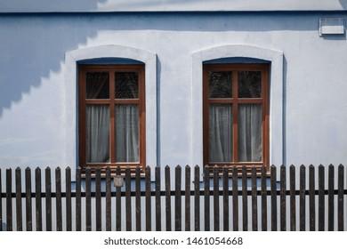 Windows of a traditional log cabin in Zilina region, Cicmany Slovakia.