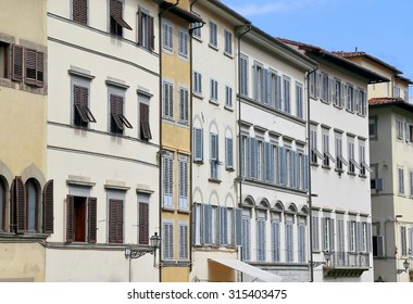 Windows and wooden balcony of a building in a historic Italian city