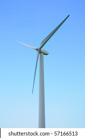Wind-powered generator against the blue sky