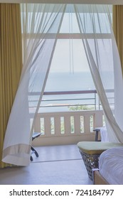 Winds blowing curtains on the balcony with sea view