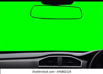 Windshield and rear view mirror ,View inside the car with green scree Isolated on background with clipping path.