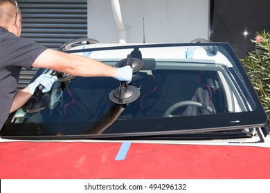 Windshield replacement, man is repairing a windshield