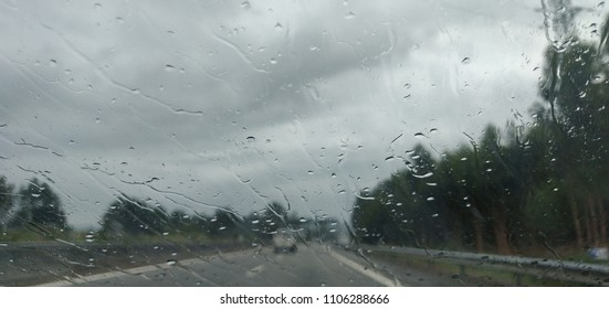 Windshield view of highway bad weather.