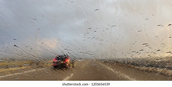 Windshield view at road bad weather.