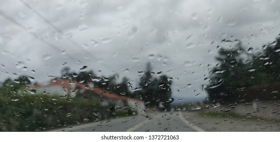 Windshield view of road bad weather.